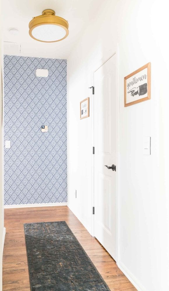 Short hallway with white walls and removeable wallpaper accent