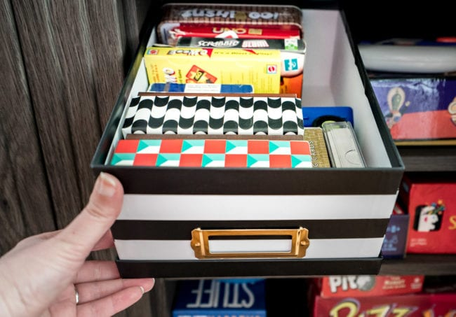 Small card games organized in a black and white photo box.