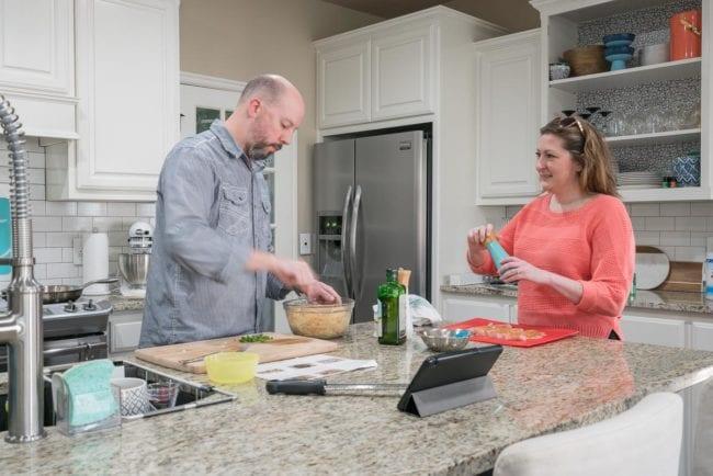 Dinner prep on a granite island in the kitchen
