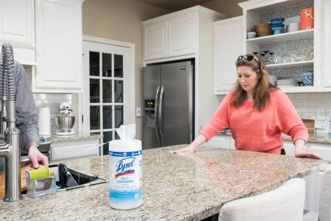 Keeping the kitchen counters clean using Lysol Daily Cleaning Wipes