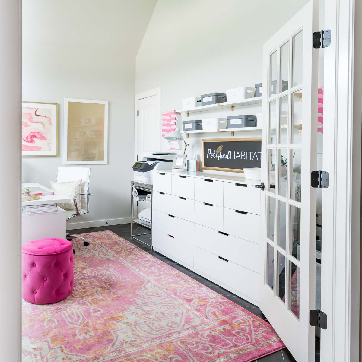 White home office with lots of storage drawers and shelves