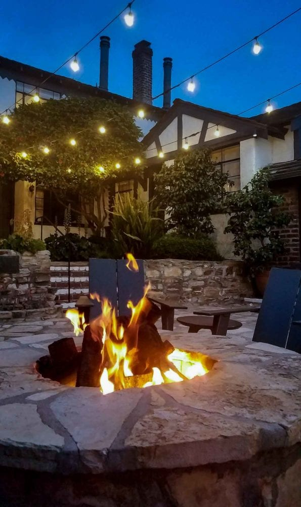 Firepit in stone courtyard - Vagabond House Inn