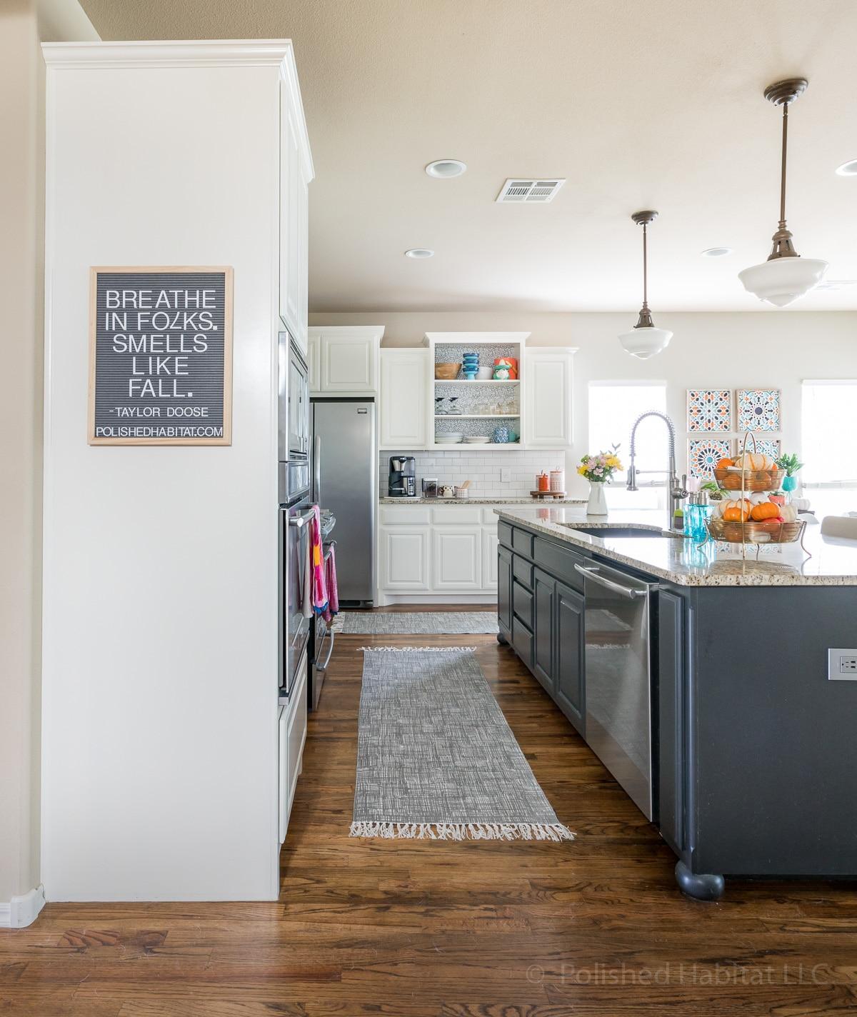 White Dove Kitchen Cabinets with black island