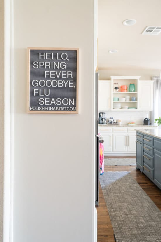 Letterboard in kitchen with Hello Spring Fever, Goodbye Flu Season quote