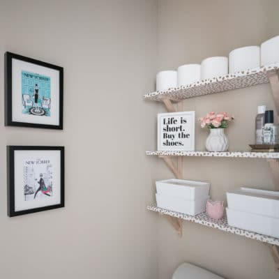 3 Shelves on wall in water closet above toilet