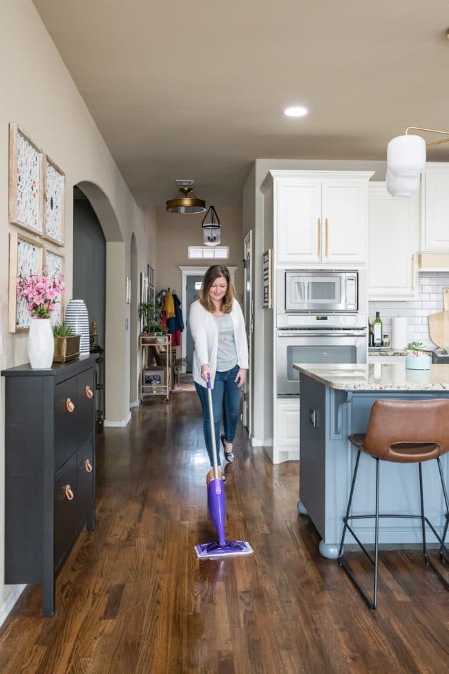 Cleaning a wood floor with a Swiffer WetJet