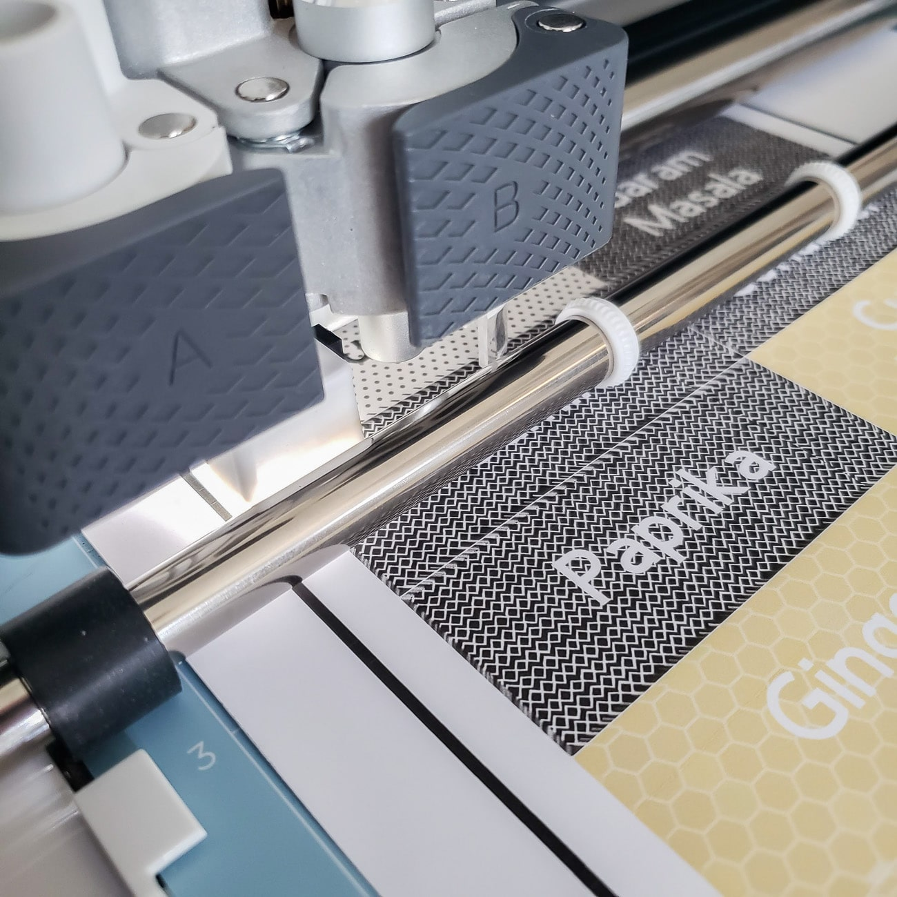 Close up of Cricut Maker Finding Guideline for Print Then Cut Labels