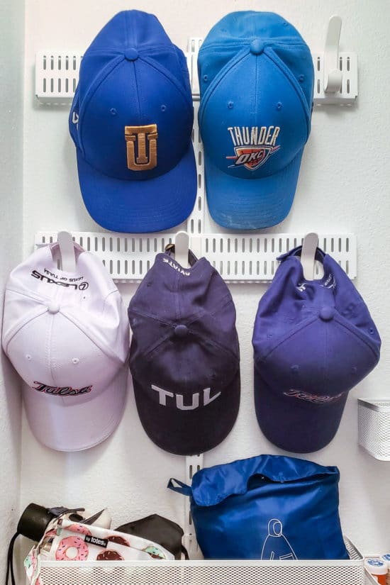 Blue baseball hats mounted on wall.
