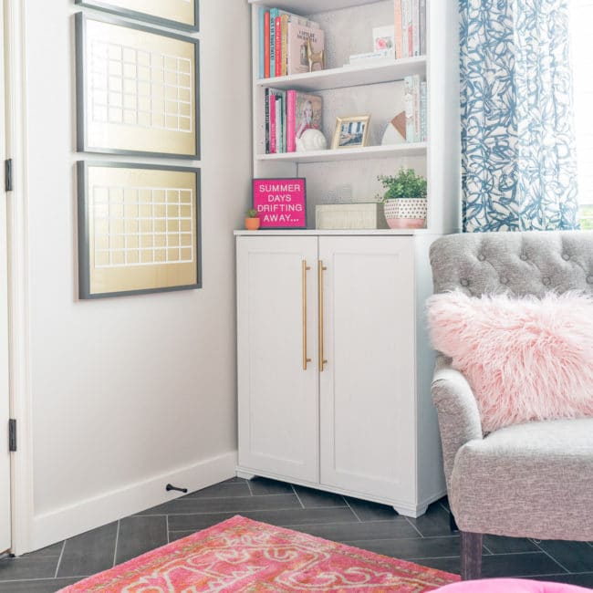 White bookcase with pink letterboard that says Summer Days Drifting Away