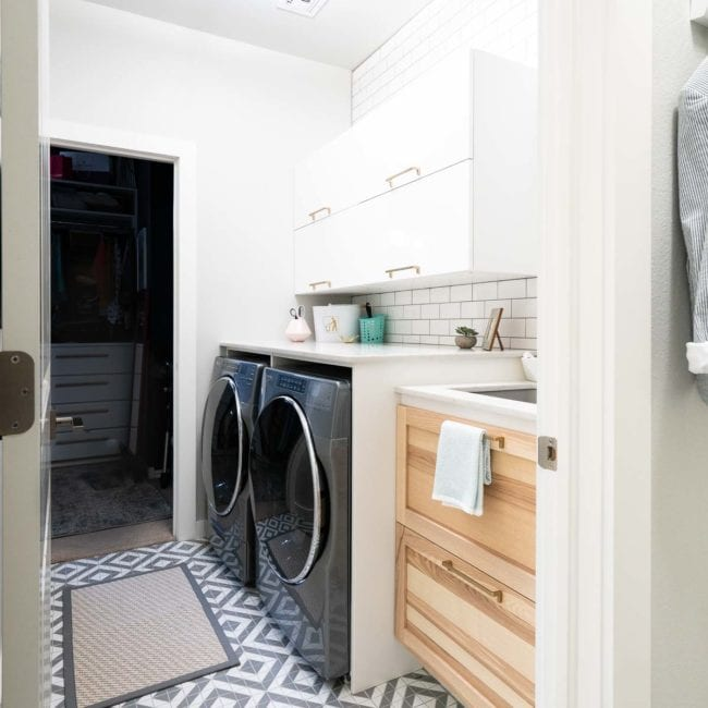 Small Laundry room with marble countertop and sink and wood cabinet