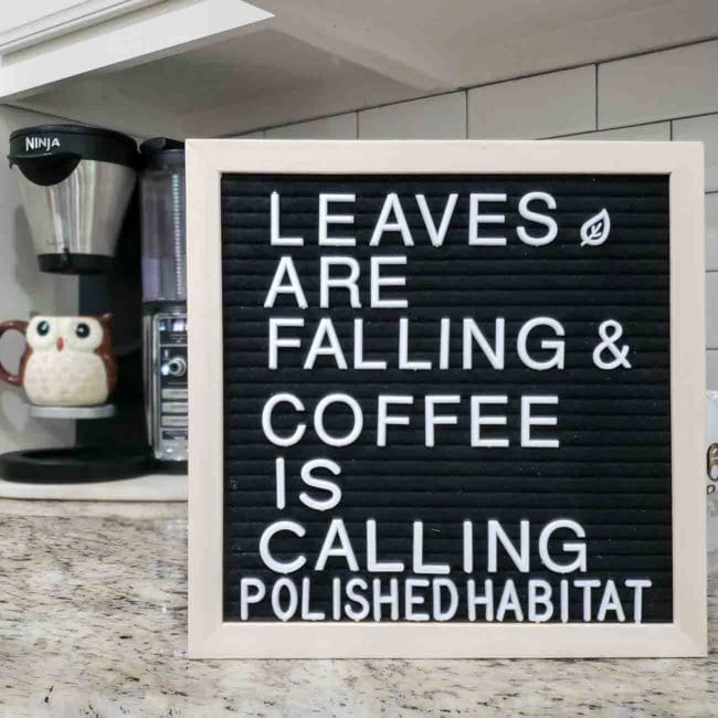 Black letter board with white letters - Leaves are falling & coffee is calling.