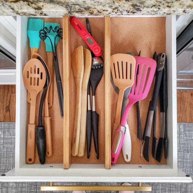 Kitchen cooking utensils in organized drawer