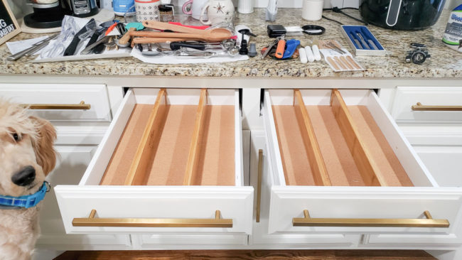 Wood dividers show in empty kitchen drawer
