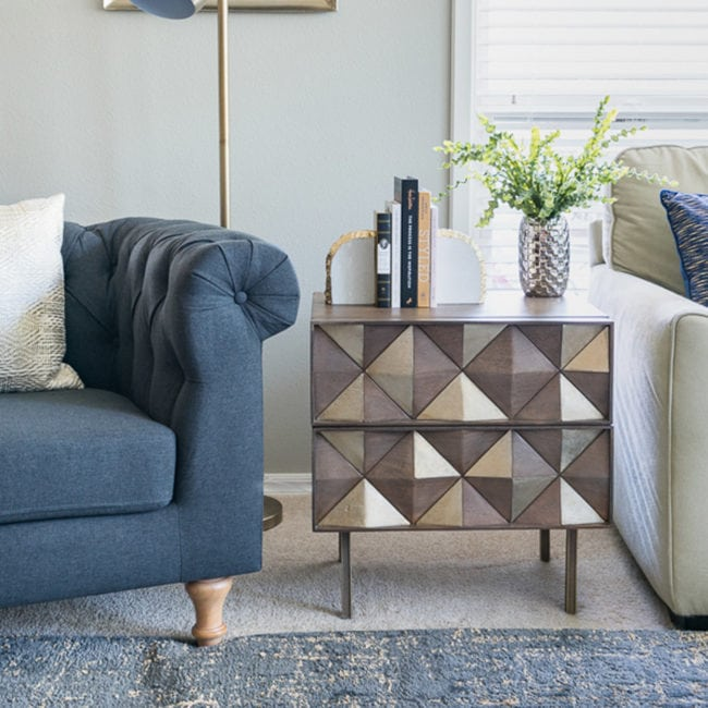 Gray chair with glam end table with drawers