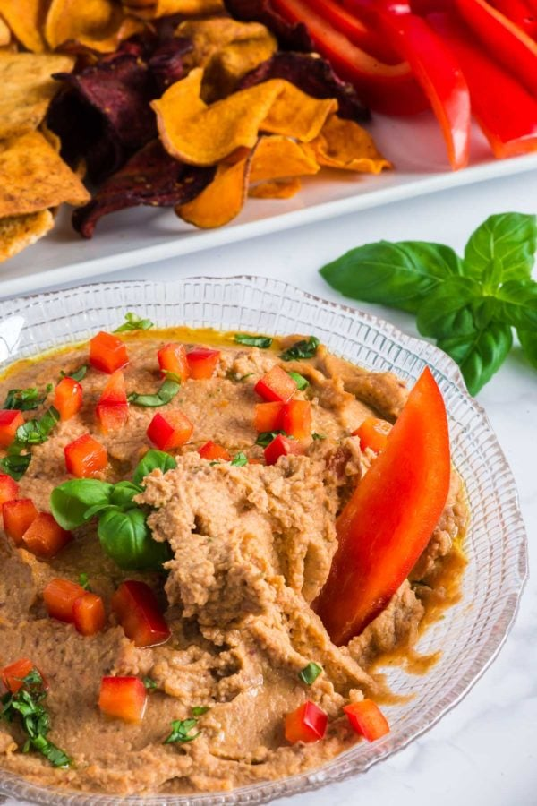 Red pepper slice in hummus