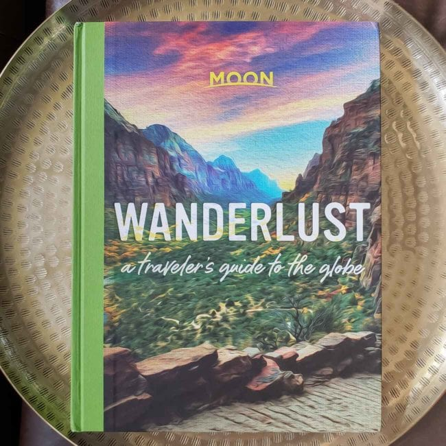 Wanderlust travel book with canyon & colorful sky on the cover