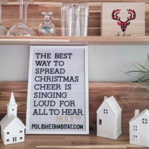 White letter board with black letters on wood shelf for Christmas