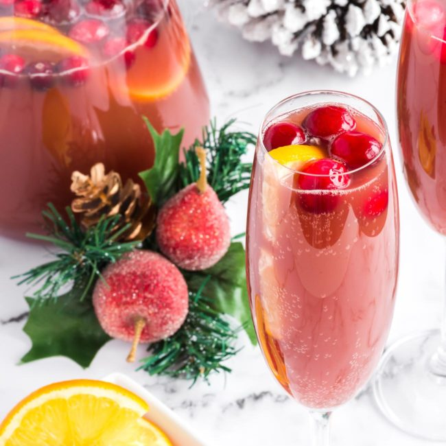 red pomegranate mimosa in christmas scene on white marble