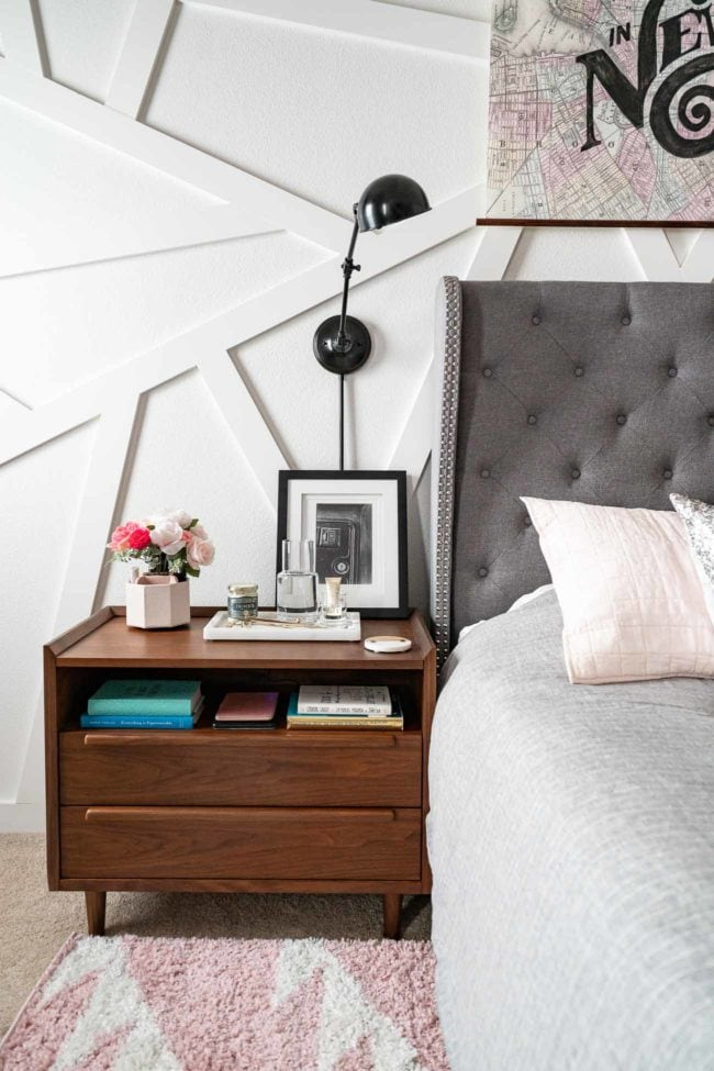 Wood MCM Nightstand with wall mounted lamp on white modern accent wall.