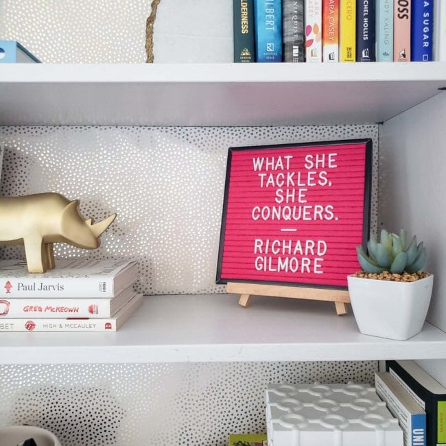 White girly office shelves with pink new years letter board
