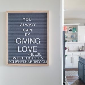 Grey Letter Board with White Letters - You Always Gain by Giving Love.