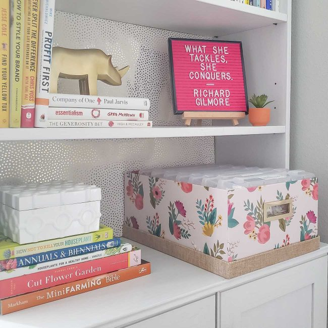 White bookcase with letter board and pink box with letter board letter containers