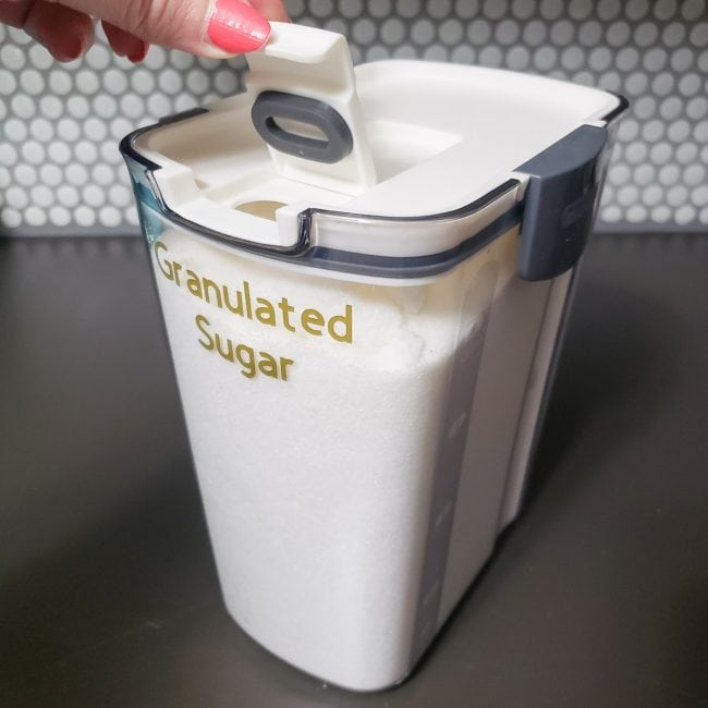 Clear container full of granulated sugar
