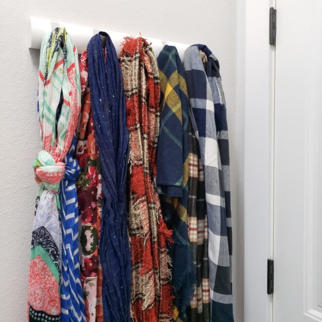 Scarves hanging on coat rack