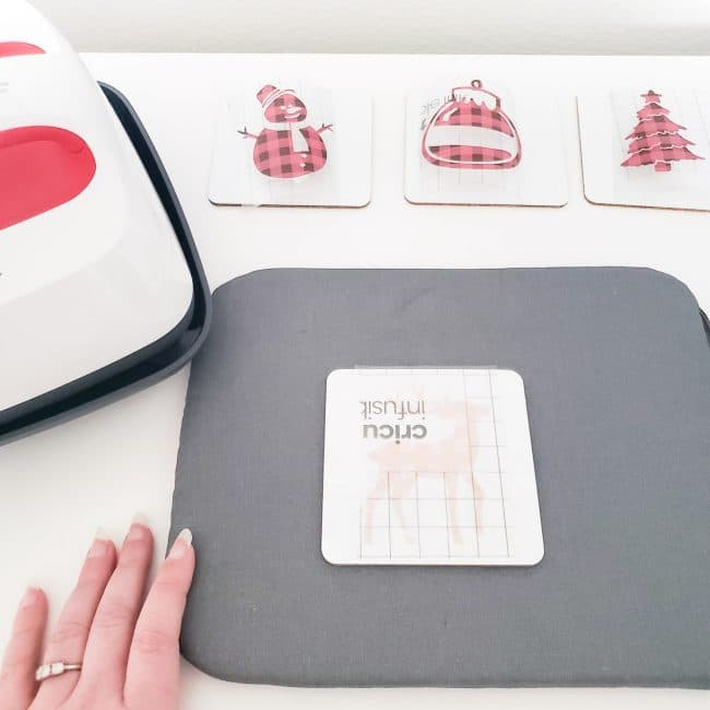 grey heat mat with coaster getting ready for heat press