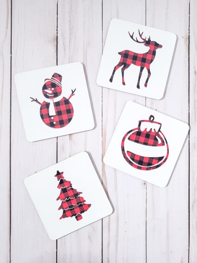 Four white coaster with various holiday buffalo check designs
