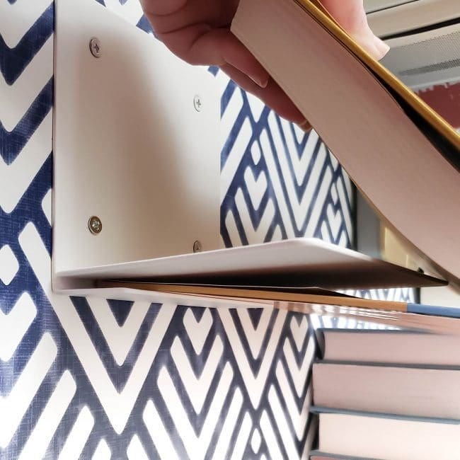 Demonstration of Putting a Book onto a metal invisible shelf