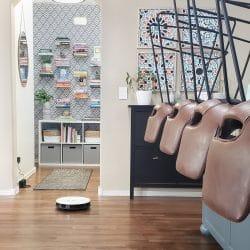 white robot vacuum cleaning wood floor