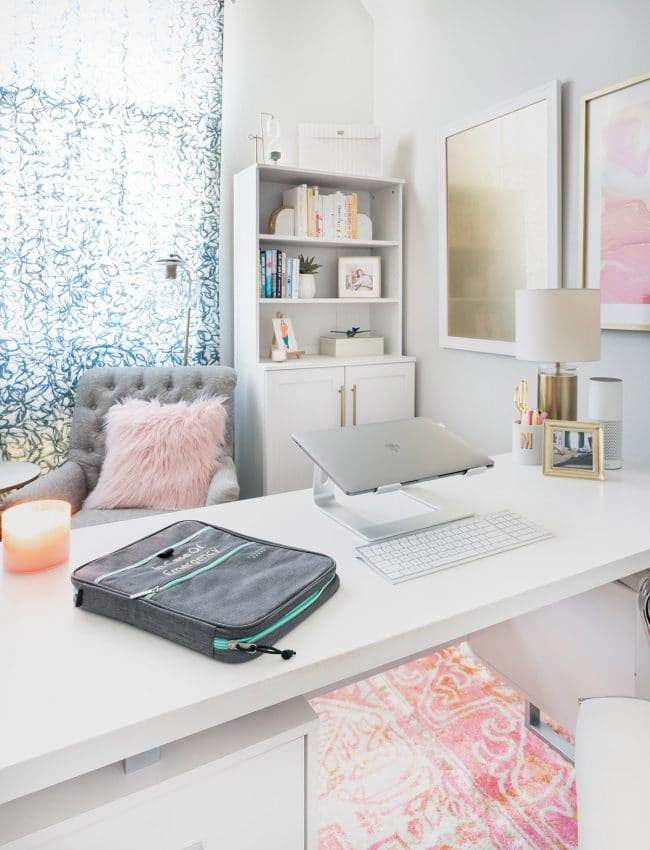 Binder labeled In Case of Emergency on white desk in feminine office