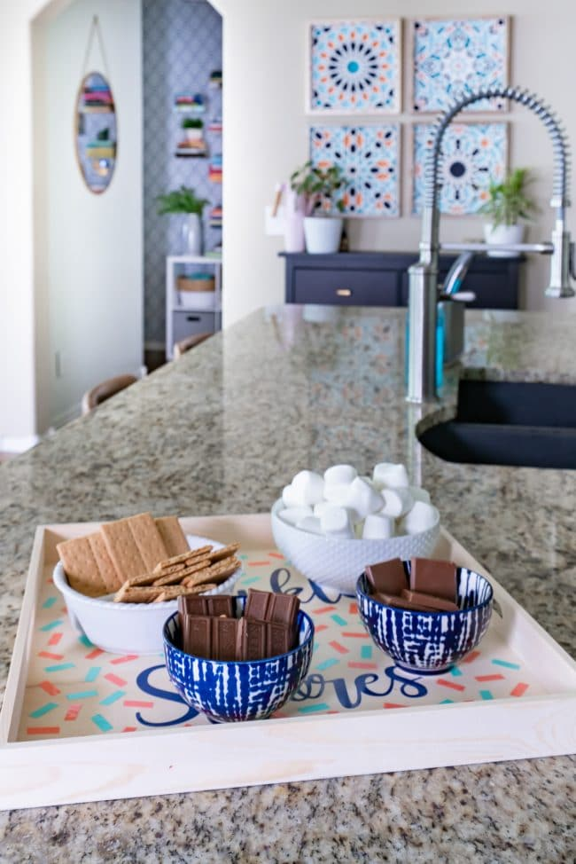 Tray of S'more ingredients in kitchen with granite countertops