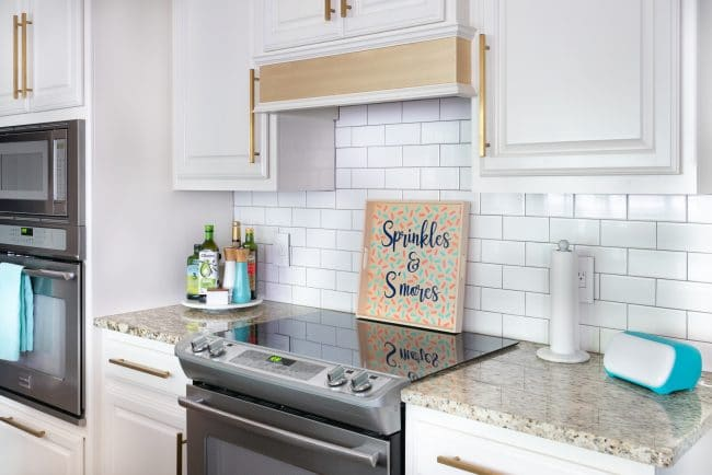 White kitchen with granite countertops and wood sprinkles & S'mores tray