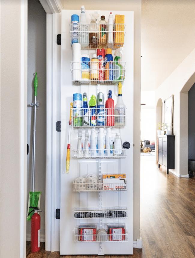 Open Hallway Door with Organized Rack of Cleaning Supplies mounted to the door